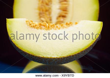 Close-up de tranche de melon Banque D'Images