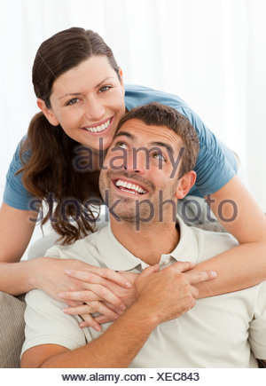 Portrait of a pretty woman hugging her husband Banque D'Images