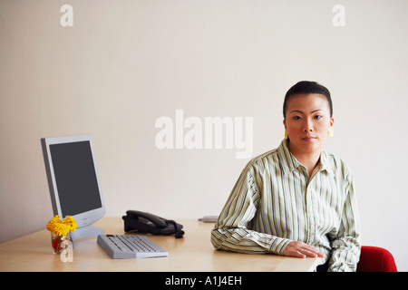 Portrait of a young woman sitting in an office