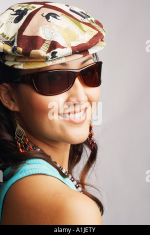 Portrait of a young woman wearing Sunglasses and smiling