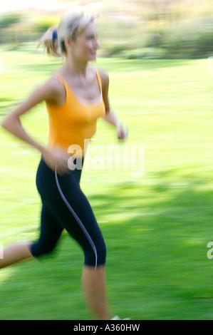 Frau beim Joggen, woman jogging Banque D'Images