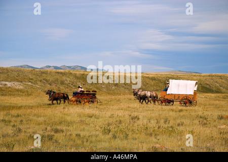 Cowboys sitting dans les wagons Banque D'Images