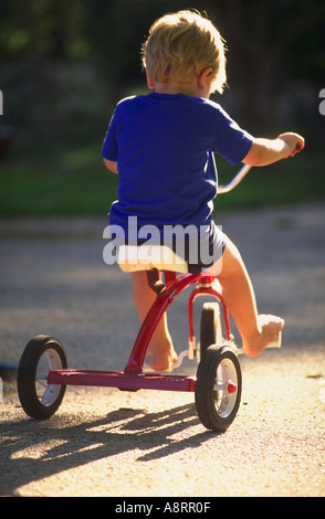 Trois ans boy riding tricycle