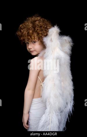 Enfant avec ange ailes s Banque D'Images