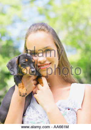 Teenage girl with puppy dog Banque D'Images