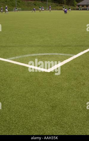 Les hommes jouaient au hockey sur surface tous temps artificielle de l'Université d'Aberystwyth - ange obtus marqué au coin de la hauteur