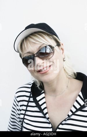 Close-up of a young woman wearing Sunglasses and smiling