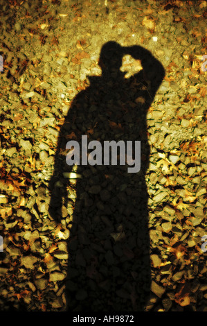 Photographe taking self portrait avec ombre Banque D'Images