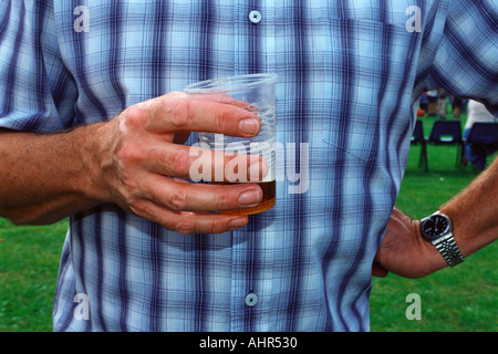 Man drinking beer in garden