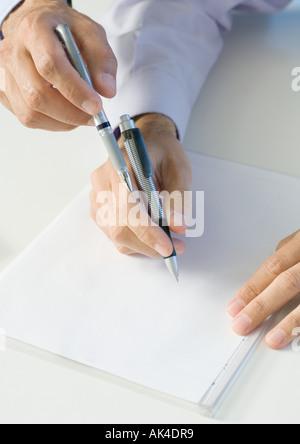 Hommes d'enclos sur le papier Banque D'Images