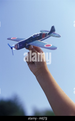 Boy Playing with a toy airplane Banque D'Images