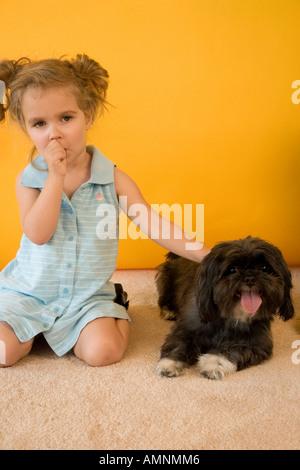 Studio Portrait of a Young Girl with puppy dog Banque D'Images