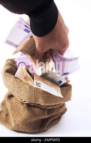 Prendre de l'argent homme sac Banque D'Images
