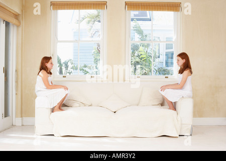 Sisters Sitting on Sofa