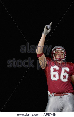 Football player holding up index Banque D'Images