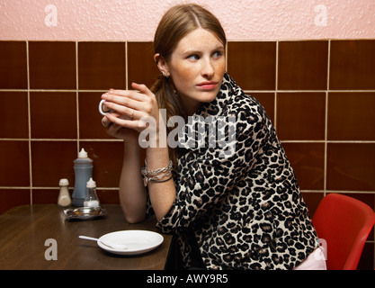 Portrait of Woman in Restaurant Banque D'Images