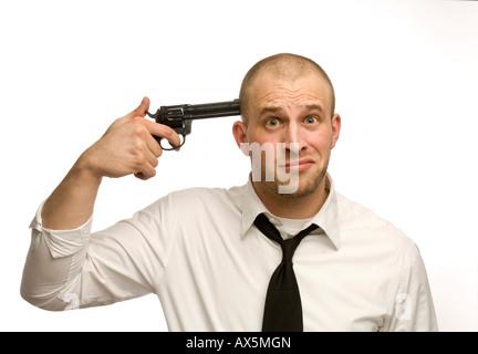 Young man holding pistolet jouet à son temple Banque D'Images