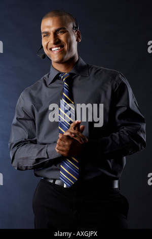 Happy Businessman Wearing Headset Banque D'Images
