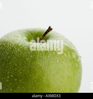 Close up of apple avec les gouttelettes d'eau Banque D'Images
