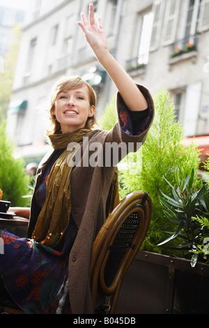 Woman Waving at Restaurant