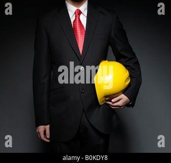 Businessman Holding Hard Hat