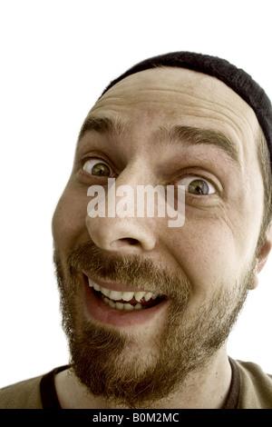 Fou rire idiot guy faire drôle de visage expression Banque D'Images
