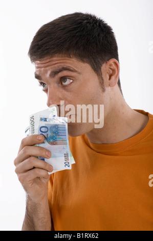 L'odeur de l'argent en espèces, homme Banque D'Images