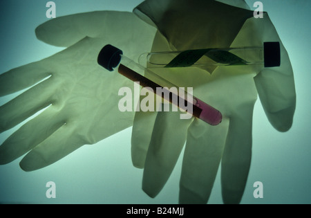 Les gants chirurgicaux et les tubes à essai ICÔNE MÉDICAL Banque D'Images
