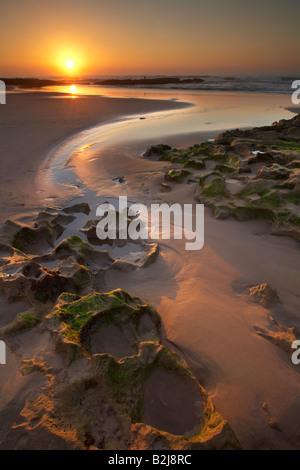 La plage au sud d'Agadir au coucher du soleil, le Maroc Banque D'Images