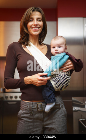 Woman with Baby in Kitchen