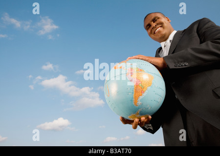 African businessman holding globe