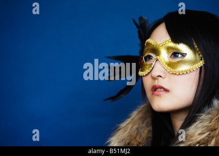 Portrait of Woman Wearing Mask Banque D'Images