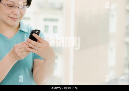 Close-up of a young woman holding a mobile phone