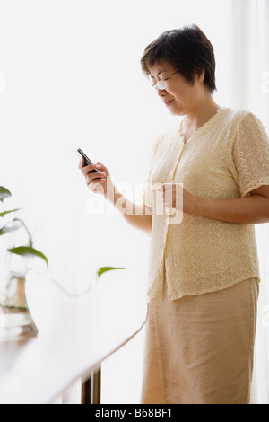 Portrait of a young woman looking at a mobile phone