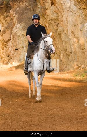 L'homme l'équitation Banque D'Images