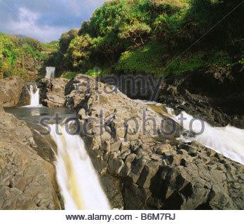 La Lower Falls et les piscines d'Oheo Gulch à Kipahulu aka sept piscines sacré Parc National de Haleakala Maui Hawaii Banque D'Images