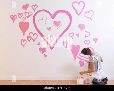 Les peintures de fille coeurs roses. Banque D'Images