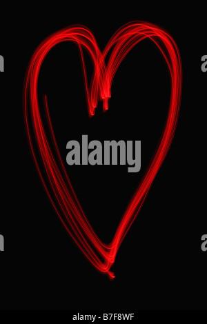 Peinture de lumière d'un cœur rouge