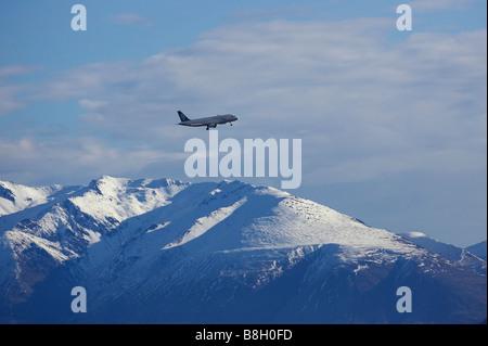 Air New Zealand jet plus de Montagnes de neige près de Queenstown ile sud Nouvelle Zelande Banque D'Images