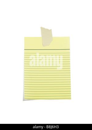 Papier ligné jaune avec du ruban de masquage Banque D'Images