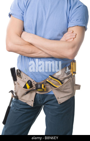 Carpenter avec une ceinture outils isolated on white Banque D'Images