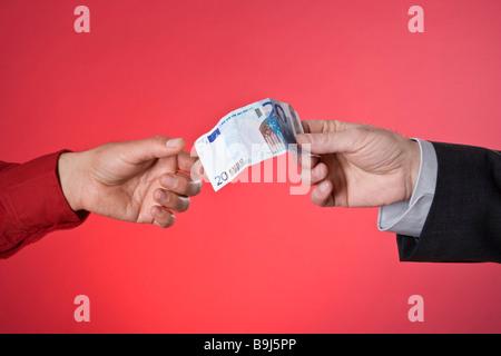 Un projet de loi Euro vingt mains echange Banque D'Images