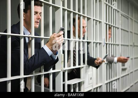 Les hommes d'affaires en prison Banque D'Images