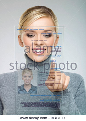 Woman using futuristic touch screen Banque D'Images