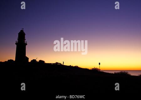 Scenic coucher du soleil avec la silhouette de Vlaming Head Lighthouse. Exmouth. Le Parc National de Cape Range. Banque D'Images