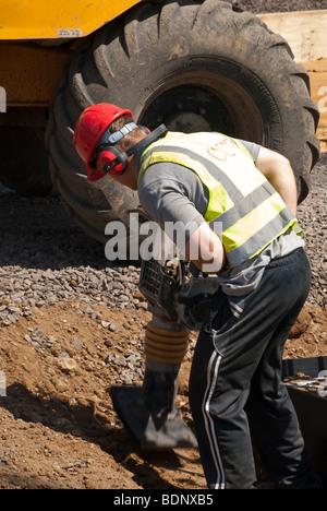 Travailleurs de la construction sur chantier Banque D'Images