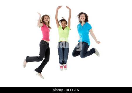 Group of Teenage Girlfriends Jumping in Studio Banque D'Images