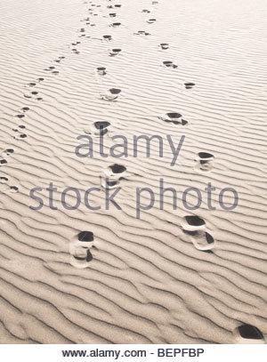 Footprints in sand Banque D'Images