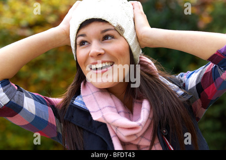 Happy girl wearing hat and scarf Banque D'Images