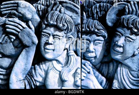 Dames et Hommes thaïlandais sculpté dans la pierre pour un jardin, la Thaïlande. Banque D'Images